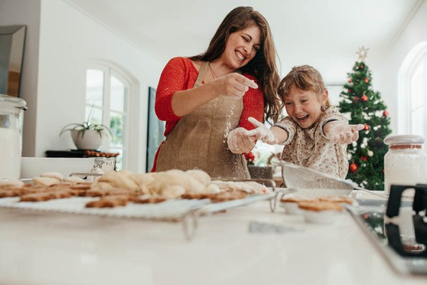 Mother and daughter having fun while making Christmas cookies.